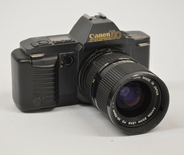 Canon T70 + zoom Canon 35-70 mm 1:4 usata (Senza:cinghia,tappo)